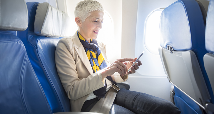 Woman using in-flight broadband